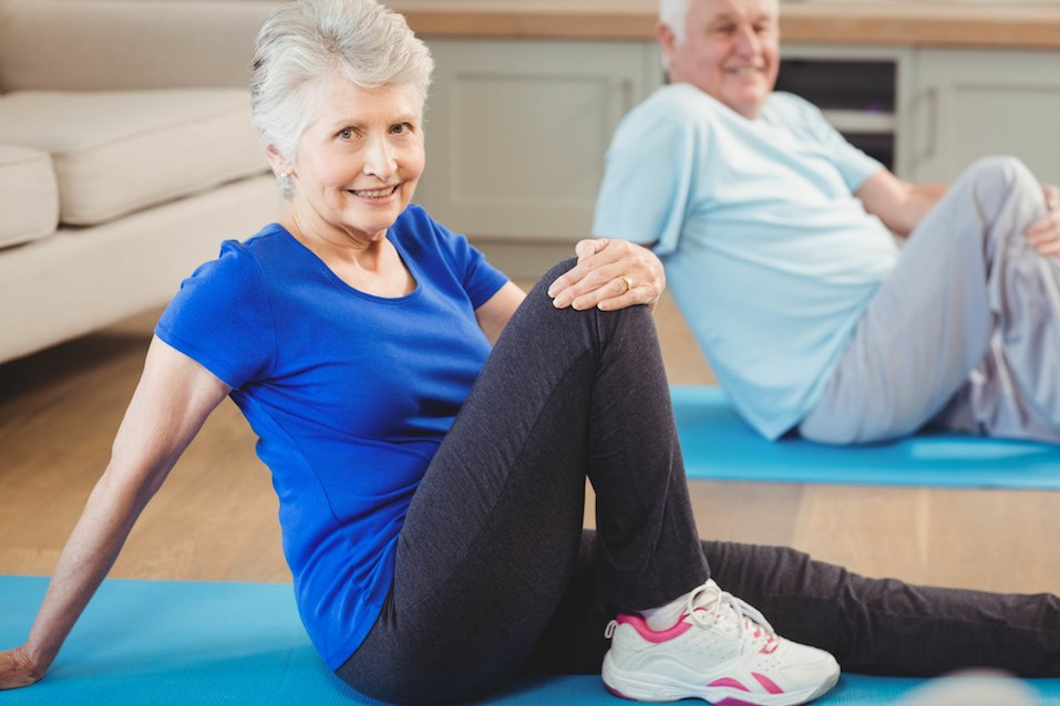 Senior couple performing yoga exercise