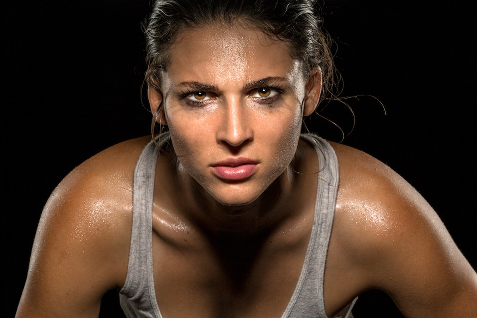 woman athlete sweating and staring into the camera