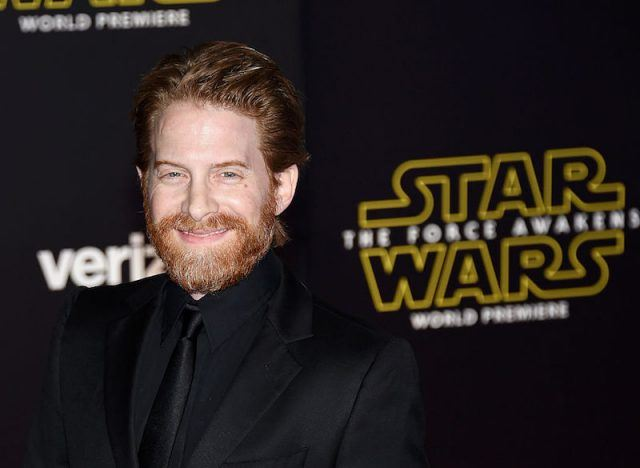 Seth Green poses in a black suit and smiles at a movie premiere.