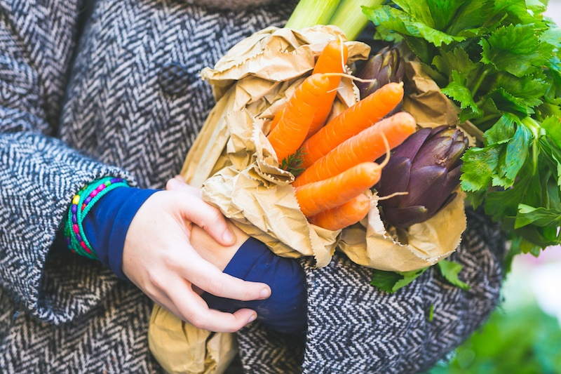 woman holding fresh veggies