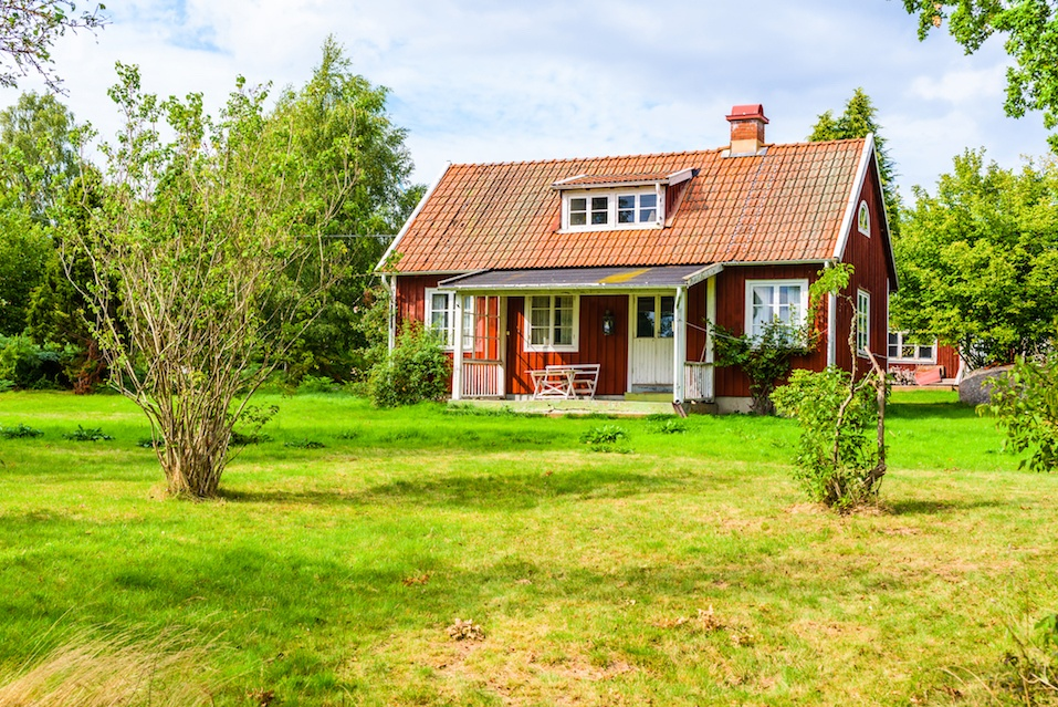 Small red wooden houses in nature are popular vacation estates