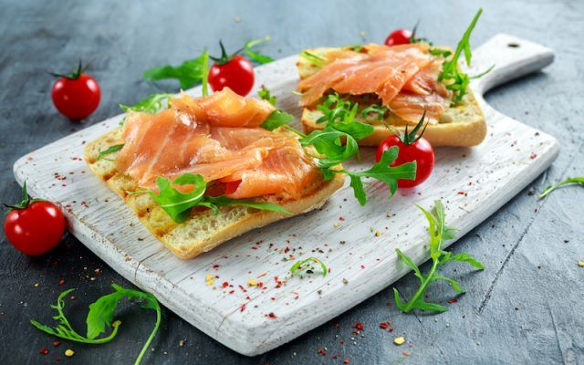 Two slices of toast with salmon.