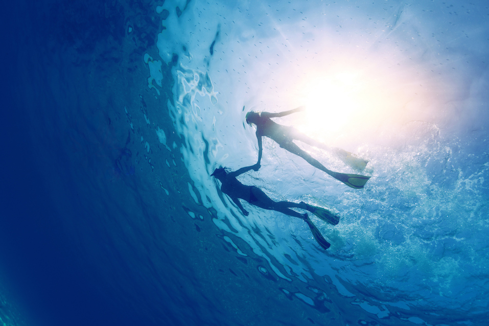 couple snorkeling in the tropical sea