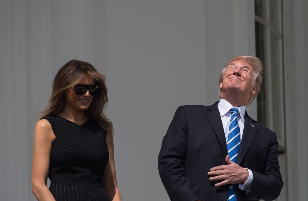 US President Donald Trump and First Lady Melania Trump look up at the partial solar eclipse from the balcony of the White House in Washington, DC, on August 21, 2017.