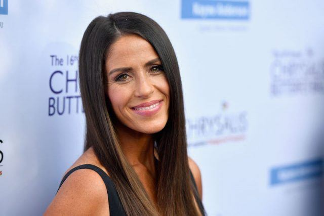 Soleil Moon Frye smiles and poses for photographers.