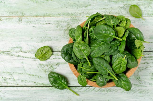 Fresh Spinach in a wooden bowl.