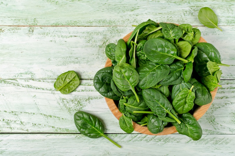 bowl of spinach on a table