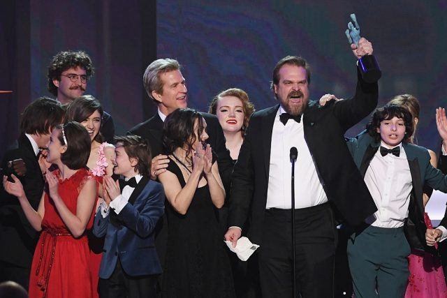 """""""Stranger Things"""" cast accepts award on stage."""