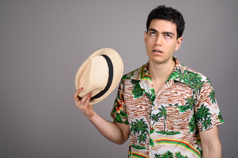 Studio shot of young handsome tourist man
