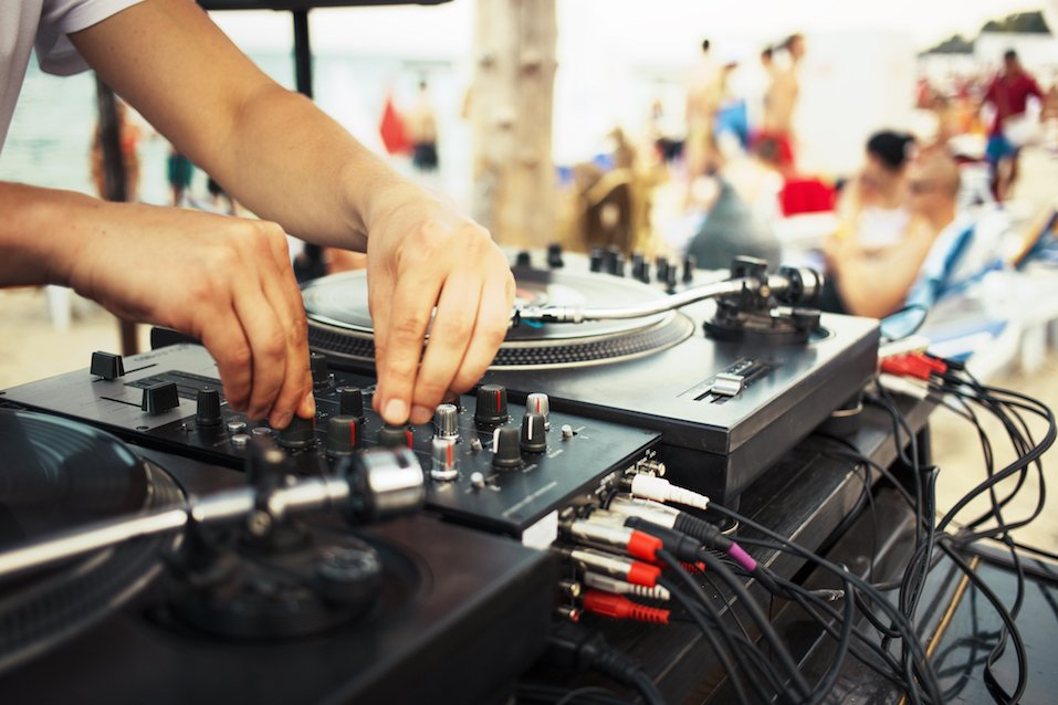 Summer beach party with a DJ spinning vinyl records