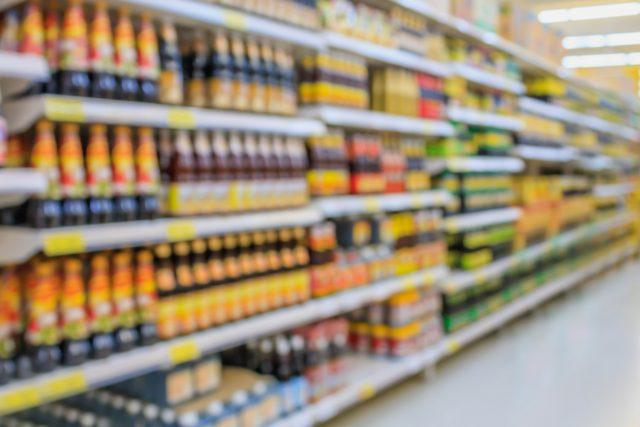An out-of-focus food aisle at a supermarket.