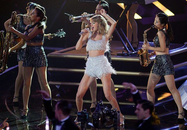 Taylor Swift performs on stage at the VMAs.