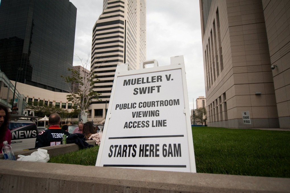 Sign placed outside Swift trial