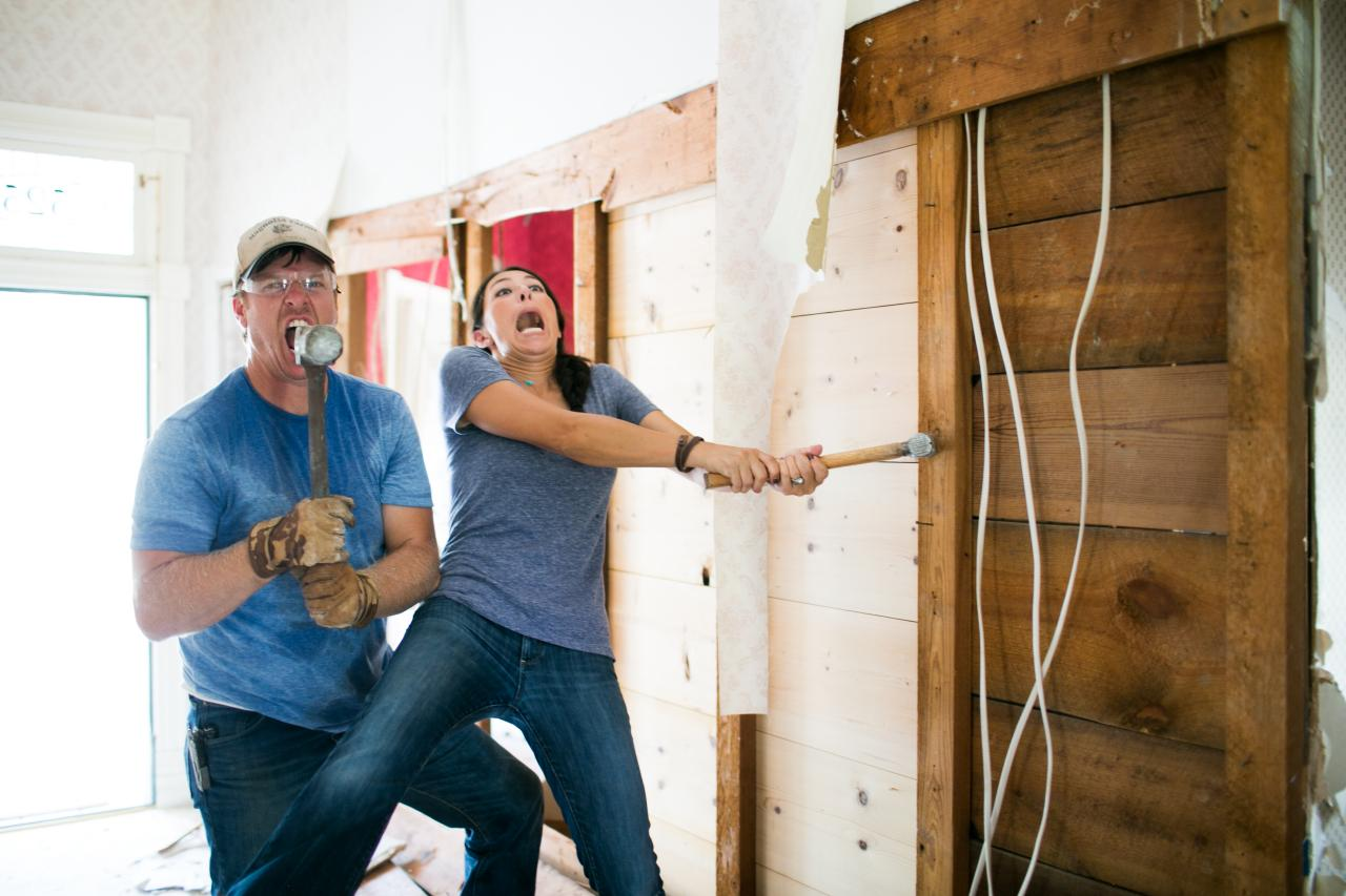 Chip and Joanna Gaines working on shiplap wall
