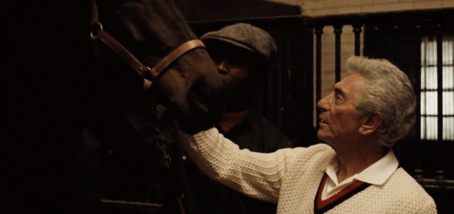 A man pets a horse in The Godfather
