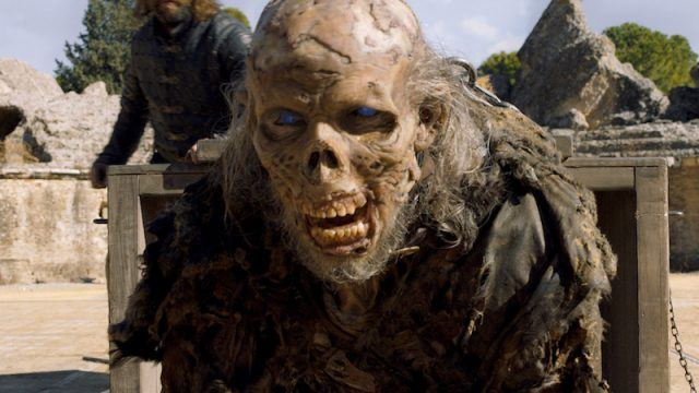 A wight coming out of a crate on Game of Thrones