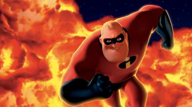 Mr. Incredible in his red suit, runs in front of bursting flames.
