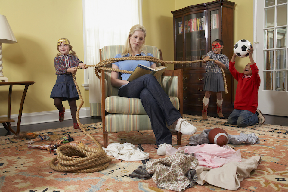 Three children (5-7 years) tying mother with rope in living room