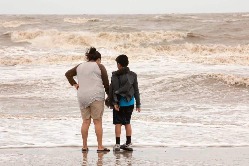 Mom and son watch the surf