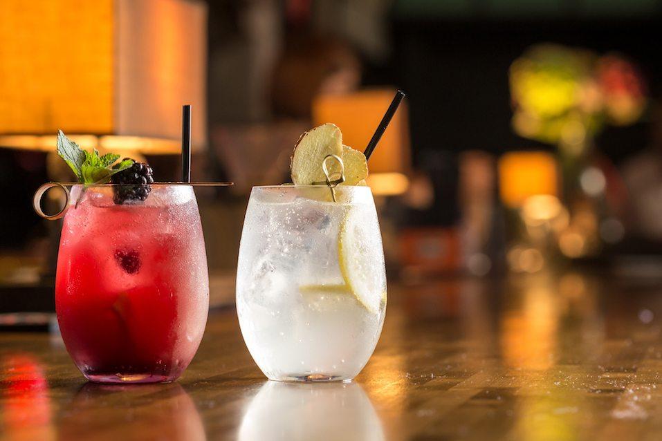 Two glasses of frozen lemonade on bar