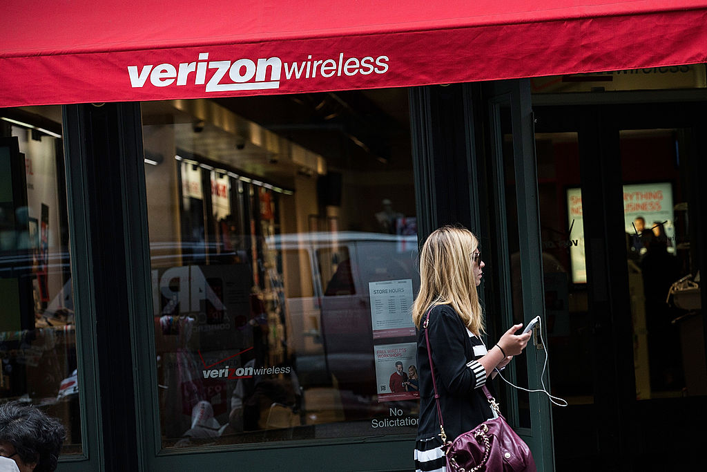 Woman walks past Verizon store