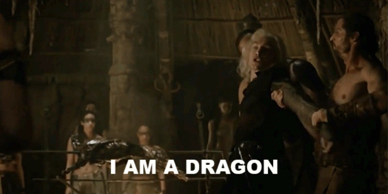 "Viserys is being pulled along with two men as he yells ""I am a dragon."""