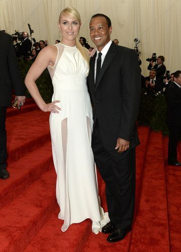 Lindsey Vonn and Tiger Woods posing on a red carpet.