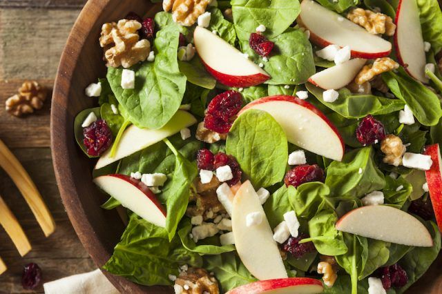 Walnuts and apples on a salad.