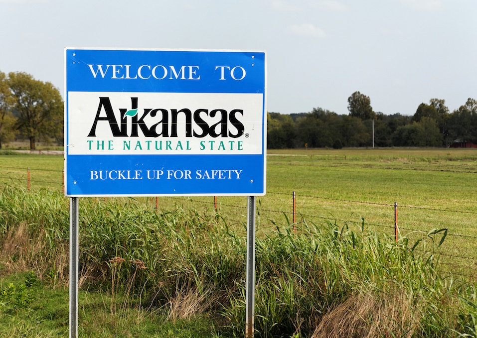 A welcome sign marks the state line between Arkansas and Oklahoma