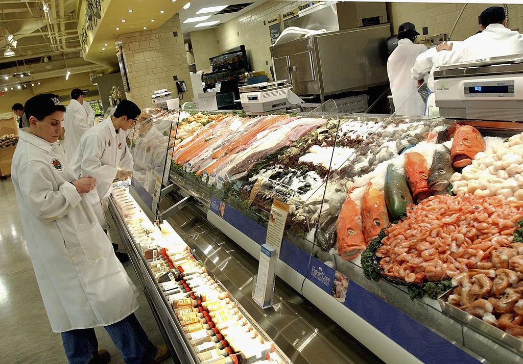 Clerks prepare Whole Foods fish department
