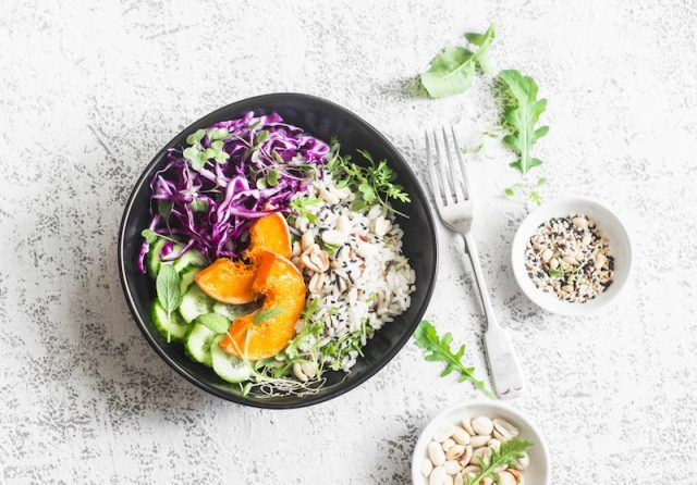 A dinner bowl with wild rice, cabbage and sweet potatoes