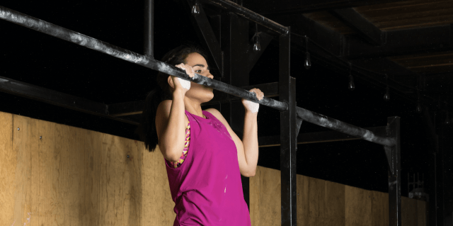 Woman performing a chin-up