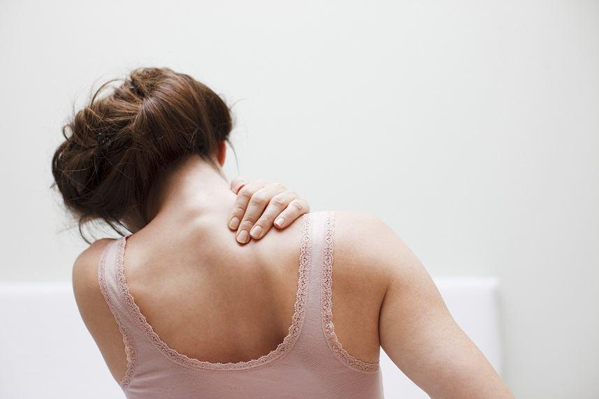 Woman rubbing aching back