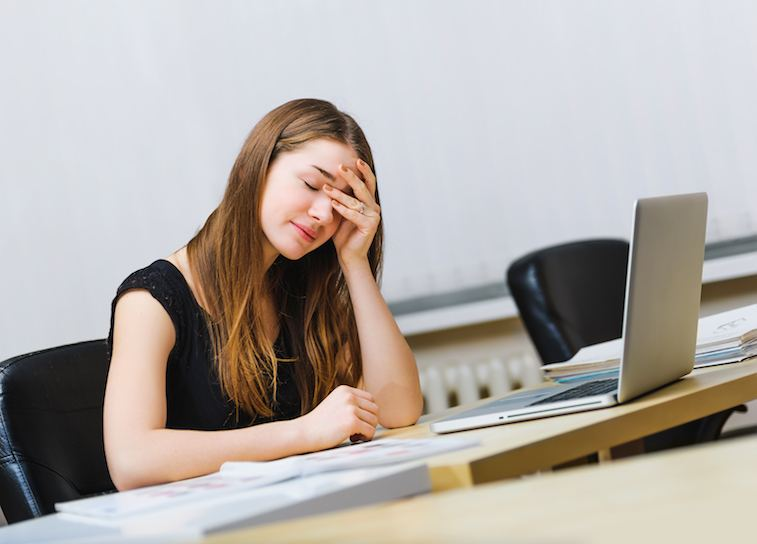 woman tired at the desk
