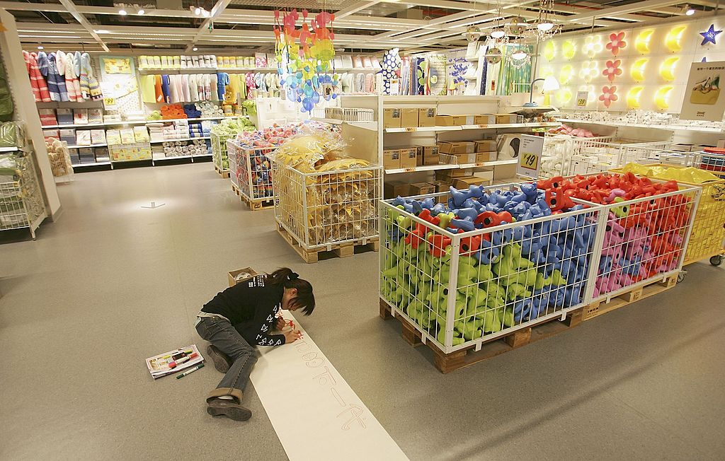A Chinese worker prepares the newly completed IKEA Siyuanqiao store