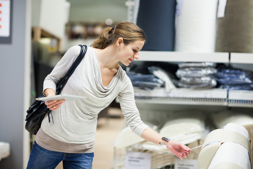 woman shopping for furniture in a furniture store
