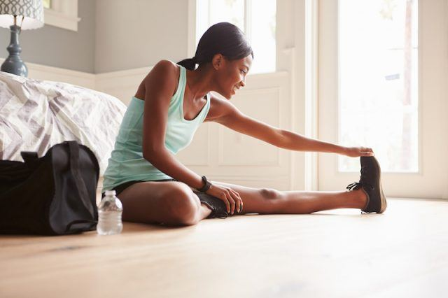 A woman stretching before or after the gym.