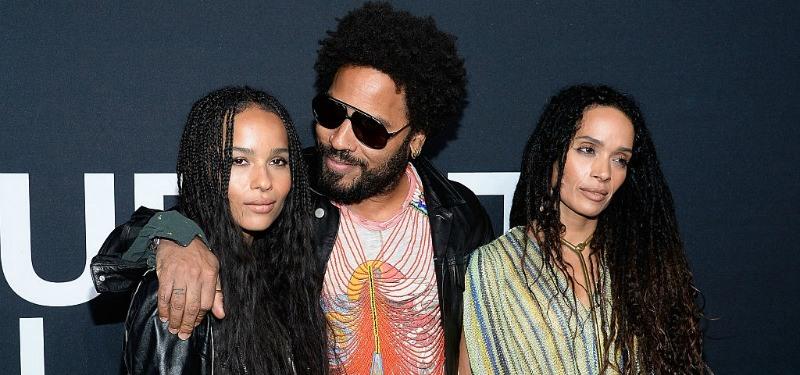 Lisa Bonet, Zoe and Lenny Kravitz pose together on a red carpet.