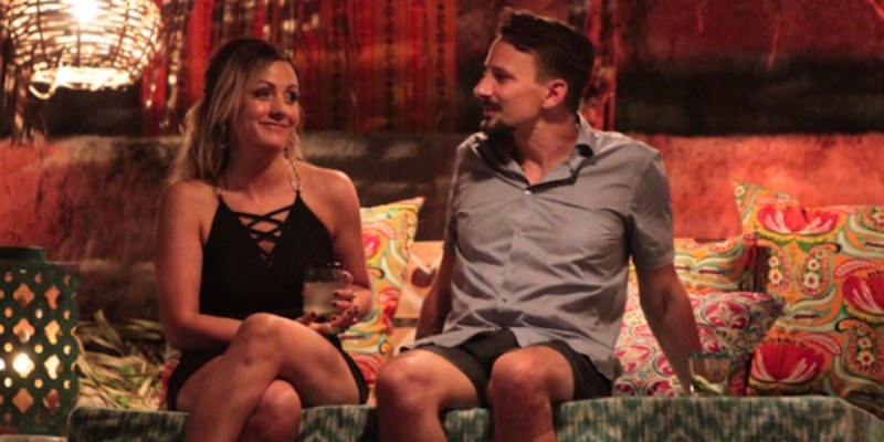 Evan Bass is sitting next to Carly Waddell on Bachelor in Paradise.