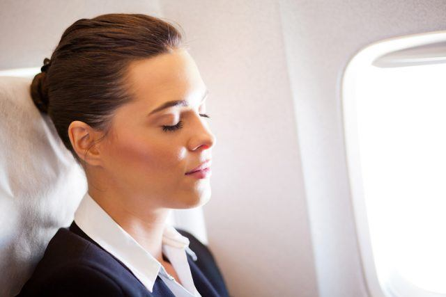 woman resting on airplane