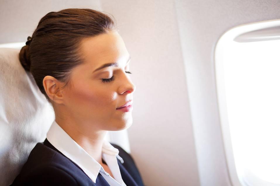 beautiful businesswoman resting on airplane