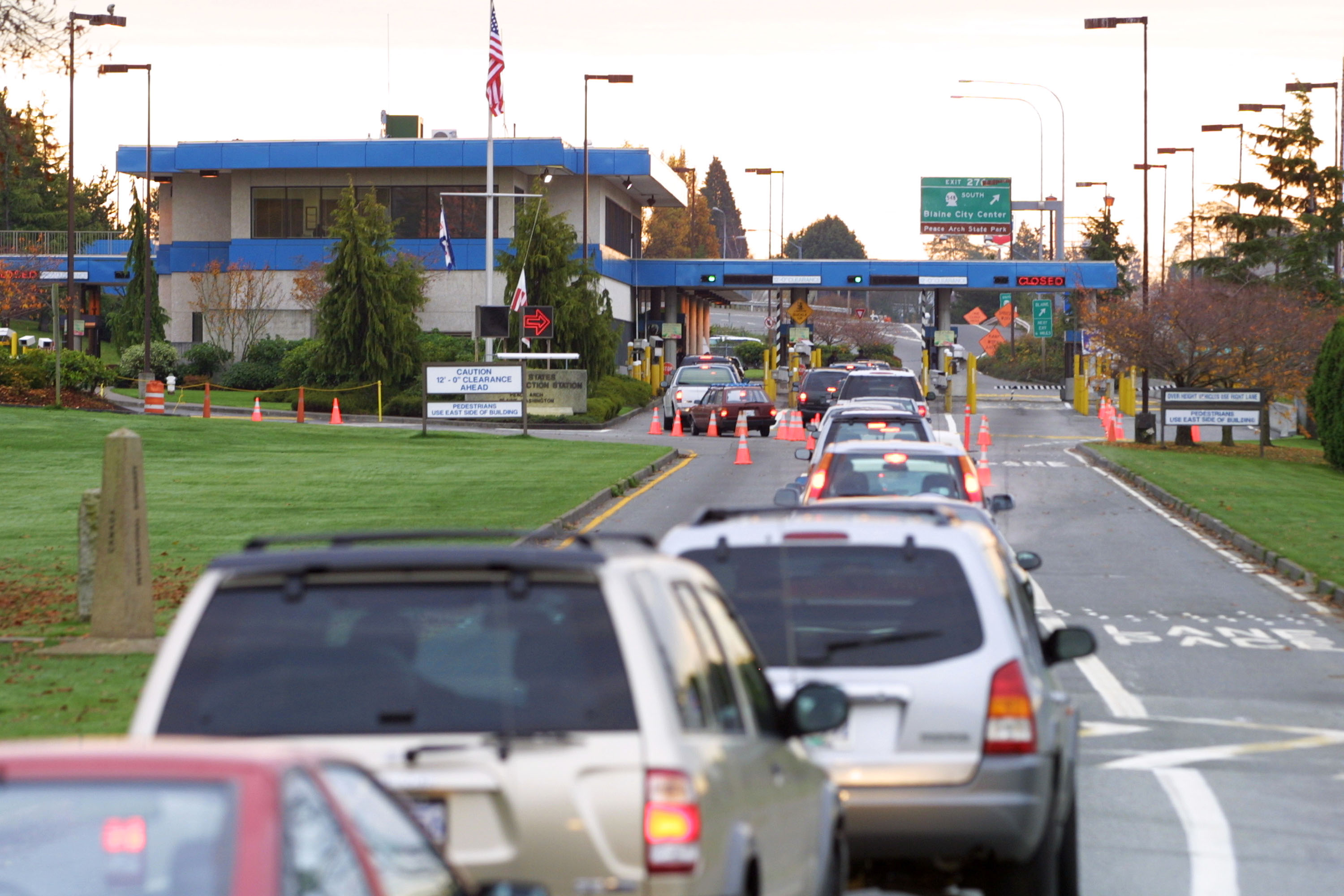 Vehicles line up to enter the United States at the border crossing between Blaine, Washington and White Rock, British Columbia