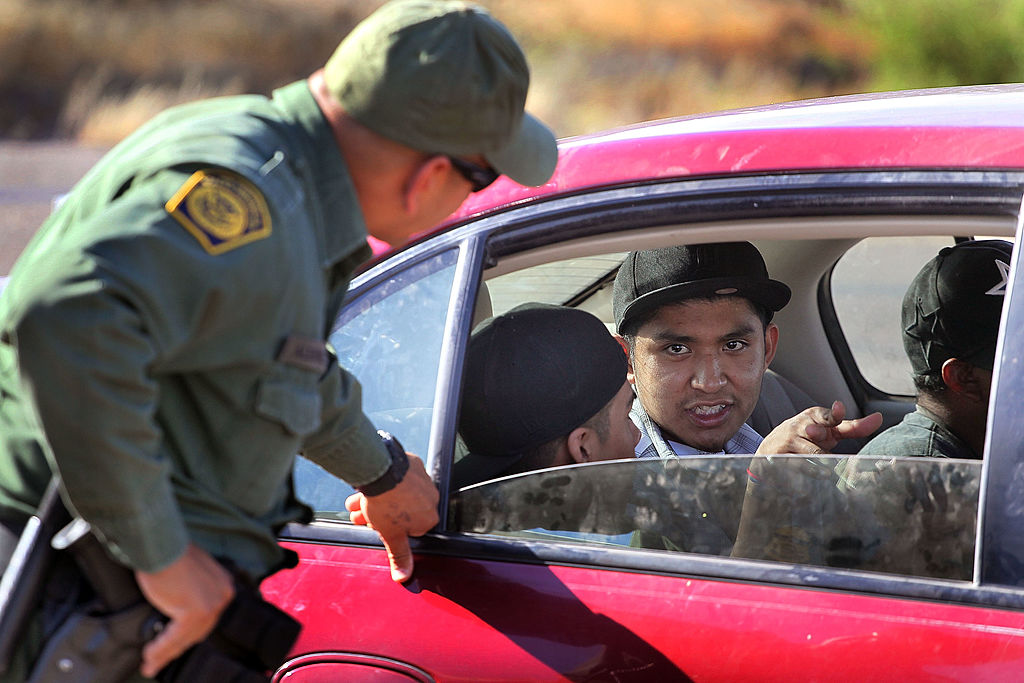 A Border Patrol agent checks vehicles for illegal immigrants and contraband