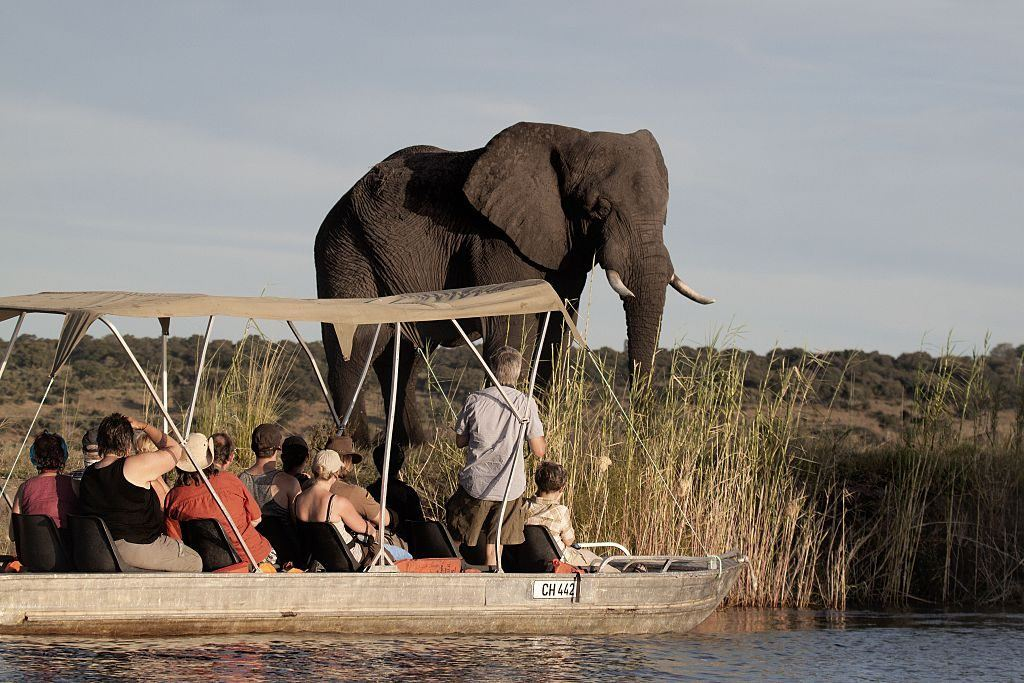 Tourists enjoy the sunset on the Chobe river in Botswana Chobe National Park, in the northeastern part of the country.
