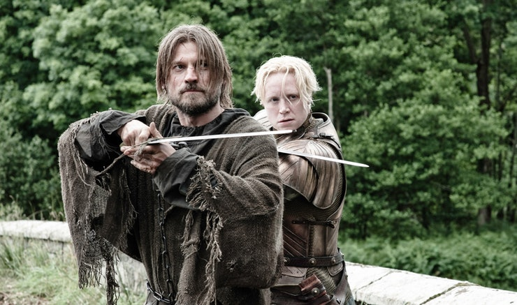 Brienne of Tarth and Jaime Lannister stand side by side holding swords