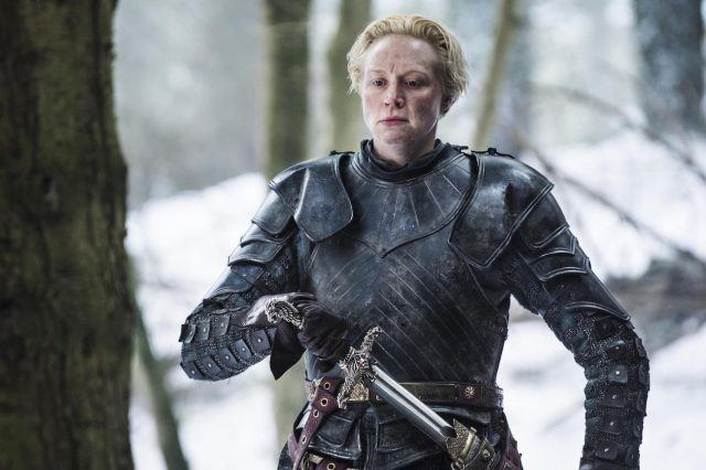 Brienne of Tarth brandishes her sword in a clearing in the woods in a scene from 'Game of Thrones.'