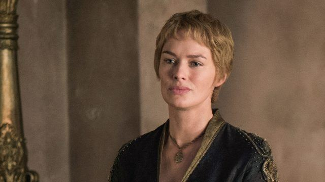 Cersei stands in front of a wall.