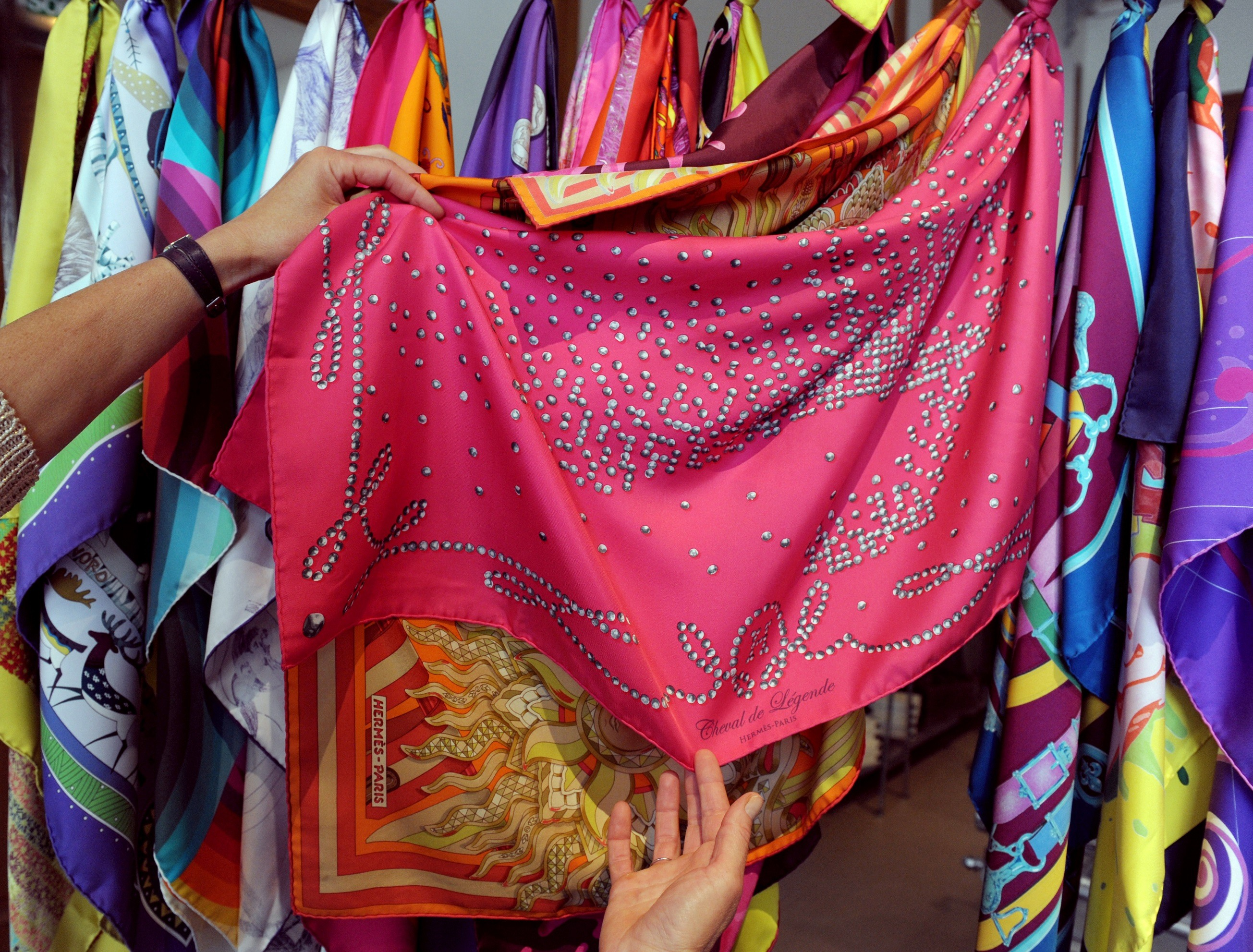 Array of colorful silk scarves
