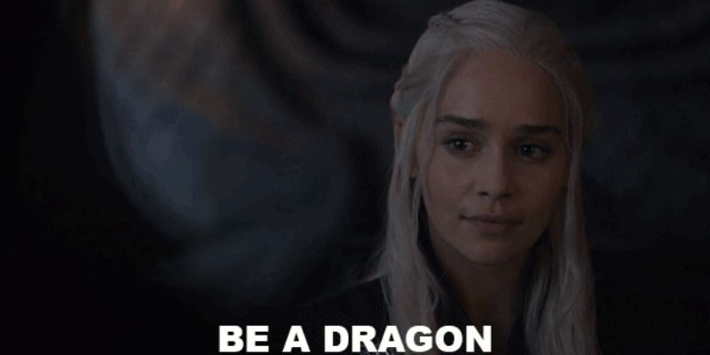 "Daenerys Targayen is smiling with the words ""be a dragon"" below her face."