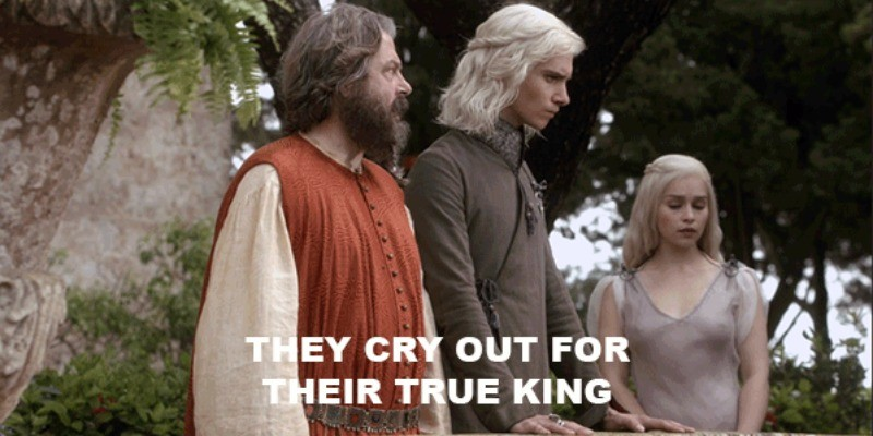 Viserys and Daenerys talk to an advisor.